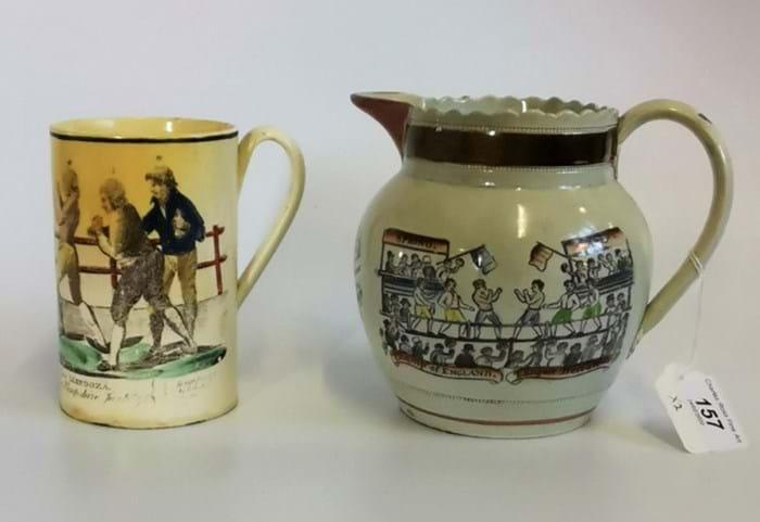 A creamware boxing mug and a pearlware boxing jug