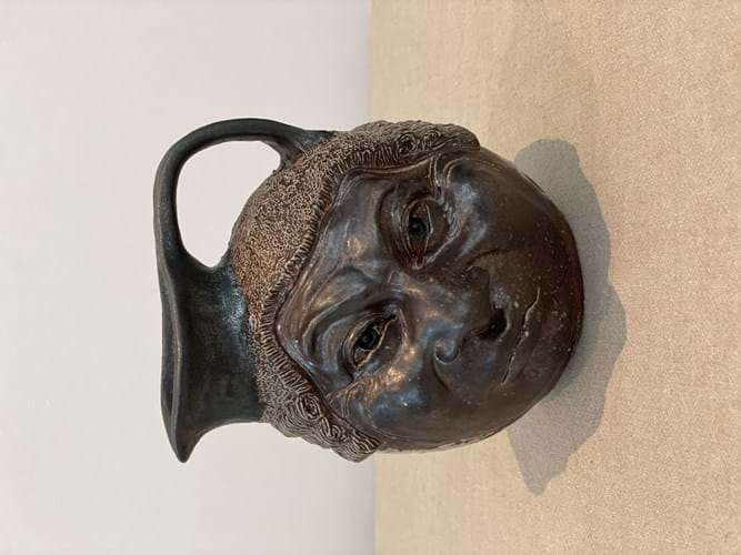 Martinware barrister face jug