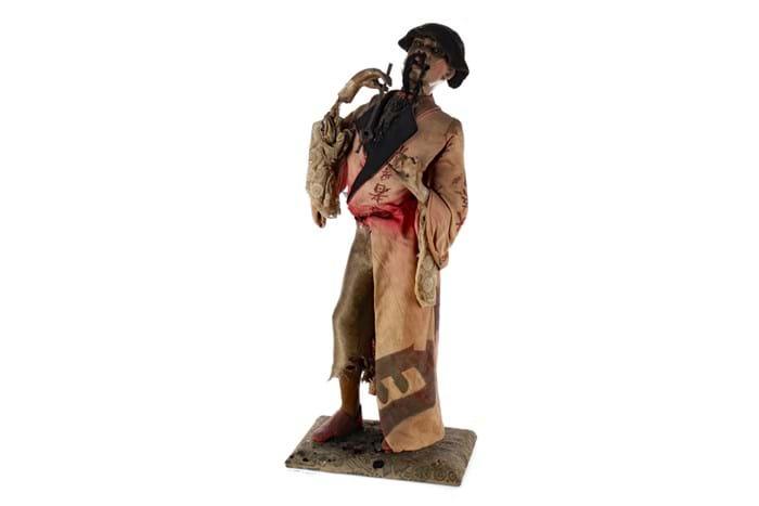 Gustav Vichy opium smoker automaton